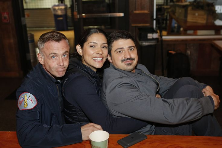 """NBCUNIVERSAL EVENTS -- """"One Chicago Day"""" -- Pictured: (l-r) David Eigenberg, Miranda Rae Mayo, Yuri Sardarov, """"Chicago Fire"""" at the """"One Chicago Day"""" event at Lagunitas Brewing Company in Chicago, IL, on October 24, 2016 -- (Photo by: Parish Lewis/NBC)"""
