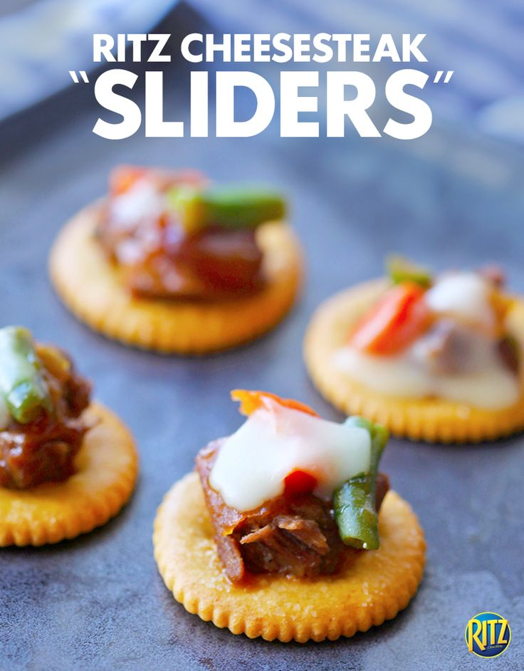 """These cheesesteak cracker """"sliders"""" make ideal appetizers to serve on game day! Cook vegetables in a skillet and mix them with shredded beef. Add melted cheese for extra flavor and place on a RITZ Roasted Vegetable cracker."""