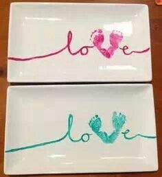 DIY Baby footprint plates. Purchase paints that can be baked, dip your bubs feet in and print in a 'V' shape. Use leftover paint to spell the word love. Allow to dry completely before baking to set. A great gift for grandparents this valentines day!