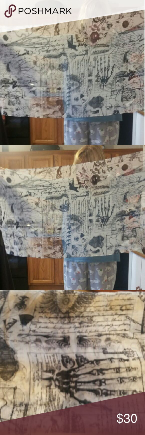 """Black and white scarf with bones and more Black and white scarf with bones and more.  Tavola Qvarta. Measures approximately 20"""" ? 71"""". Smoke-free home. EUC Accessories Scarves & Wraps"""