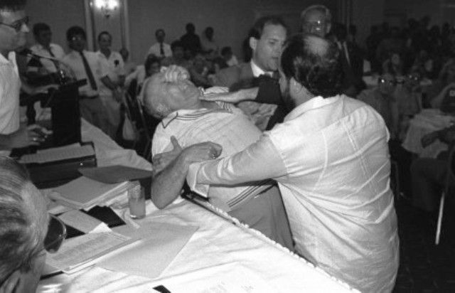 Jim Callahan's award-winning photo. Far left is party chairman the late John Guman who appears to be enjoying it all. Mario Testa has a lock on Mike Rizzitelli's nose. Rizzi's fingers gouge Mario's eye. Committeemen Raul Laffitte and David Fischer break up the battle royal at 1989 Democratic Town Committee meeting.