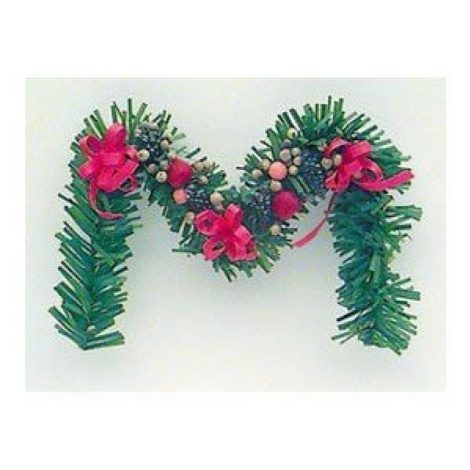 Della Robbia Fireplace Garland www.teeliesfairygarden.com Fairies will want to have a cozy living room with a fireplace. The Della Robbia fireplace garland will add more charm to your fairy living room! #fairychristmas