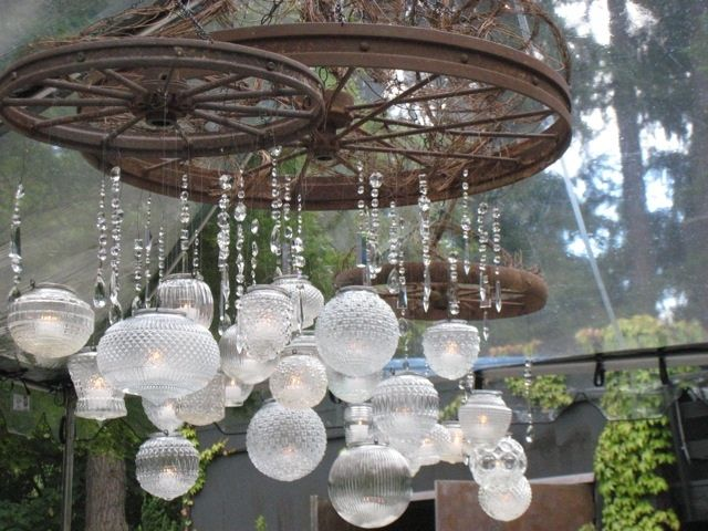 Hanging Votive ChandelierMade from Rustic Wheels, 1940's Glass Lamp Globes, and Crystal Chandelier Prisms