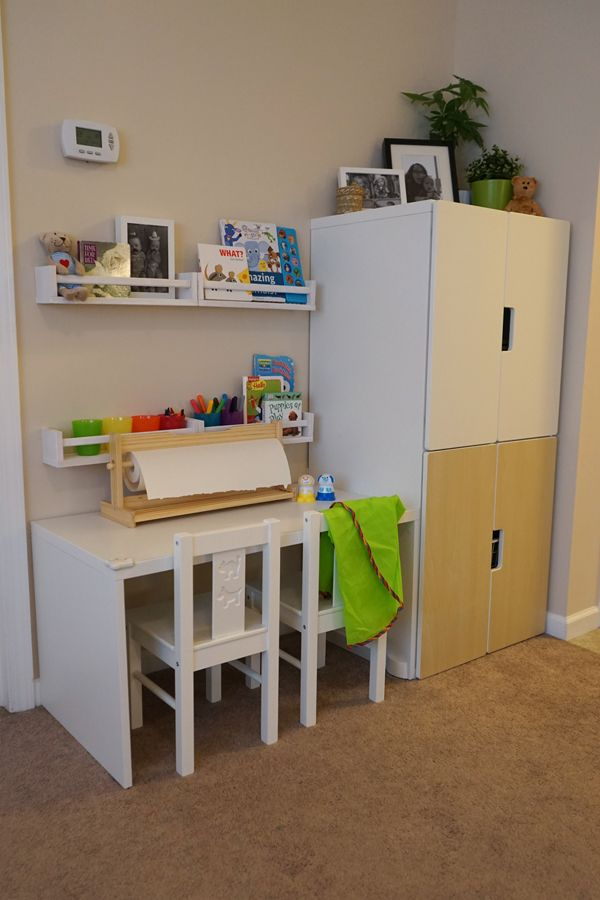 The IKEA STUVA storage bench also functions great as a desk. The IKEA Home Tour Squad paired it with the STUVA storage cabinets to house school and art supplies for young kids in their kid-friendly living room makeover.