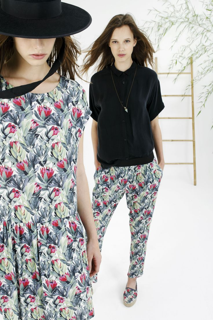 Model 1 is wearing: Floral Print, Crew neck Dress Model 2 is wearing: Black button-up Blouse, Floral Print Pant and Espadrilles -- new from Spanish womenwear brand, Indi & Cold