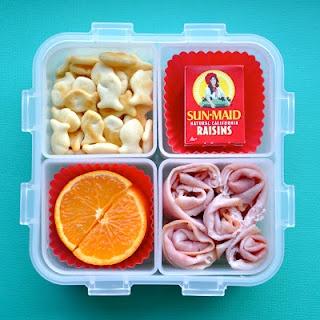 Goldfish, Raisins, Half An Orange & Turkey.