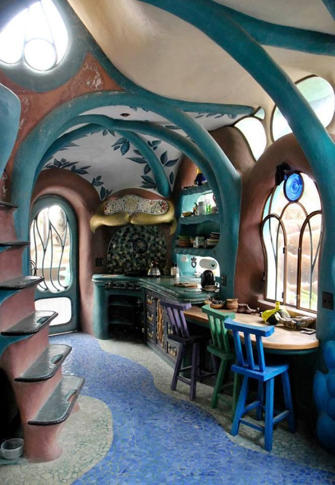 Wondrous art nouveau cob style home with ladder and mosaics and skylights and gorgeous blues. I want!