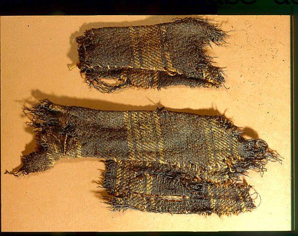 "Remains of the cloak or blanket from Guddal, Norway. Museum : Universitetsmuseet i Bergen,  InventoryNo : 031001,  Motif : Guddal-drakten, BRM 31/3. Løvlid, quoting Vedeler, says that the finds are dated 1035- 1165 CE in ""Skjoldehamnfunnet i lys av ny kunnskap""."
