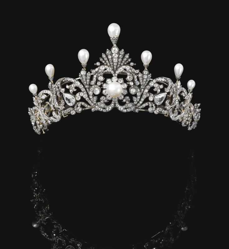 NATURAL PEARL AND DIAMOND TIARA, LATE 19TH CENTURY Of foliate scroll design, surmounted with seven drop-shaped natural pearls each in a mount embellished with rose diamonds, graduated in size from the centre, the scroll surrounds set with pear-, cushion-shaped and circular-cut diamonds, the button-shaped pearl at the centre of a cluster motif, may be detached into eight jewels, three may be worn as brooches, the two larger pear shaped diamonds are later additions