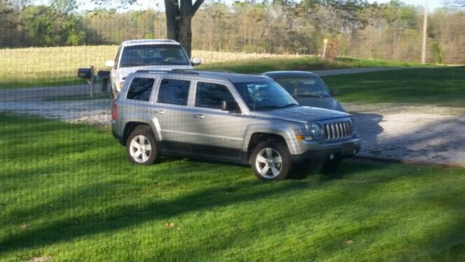 MY 2014 Jeep Patriot Sport in my driveway. Lookin good!!