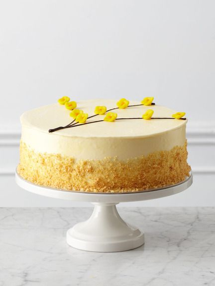 Three layers of vanilla butter cake are laced with homemade lemon curd and raspberry preserves ...