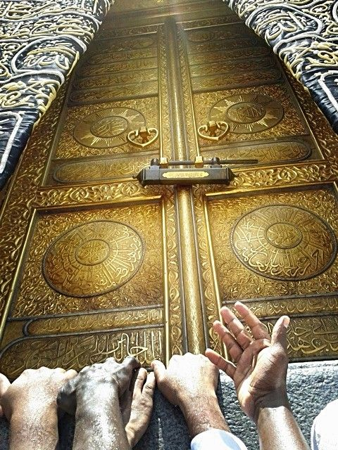Pilgrims at the Kaaba (The Cube) Door - Mecca. No different between rich or poor, black or white , a man or a woman. We're all humans.