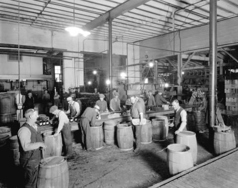 Men crating bottles of beer in a Vancouver brewery, estimated 1926. (Photo by Stuart Thomson, via Vancouver Archives)