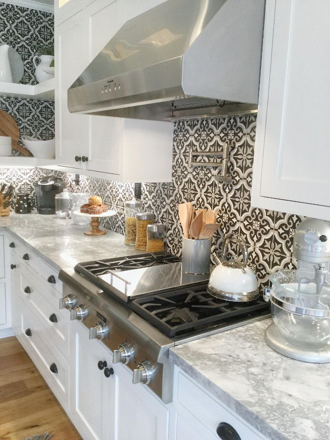 Super White Quartzite countertop.The backsplash is Merola tile from Home Depot called Baraga Classic. Thermador Professional Series appliances.