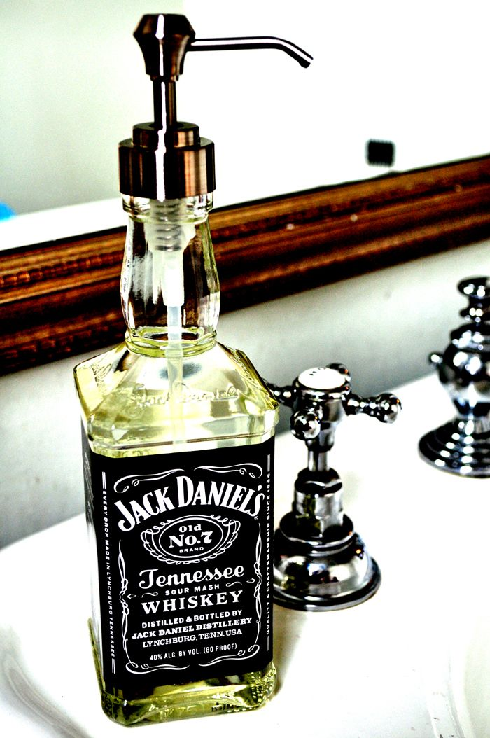 Cute mancave bathroom idea!       1. Buy a bottle of Jack Daniel's.  2. Buy a bottle of liquid soap - choose the fanciest pump you can find.  3. Pour soap into Jack bottle and screw on the pump.    Please Note: I bought soap from the kitchen section@Target. The pump thread is a universal size, but be careful to get a pump that does not bulge out at the spring as it will not fit in the bottle neck.