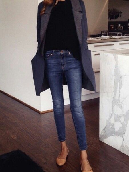 wool coat, black shirt, jeans, and boots