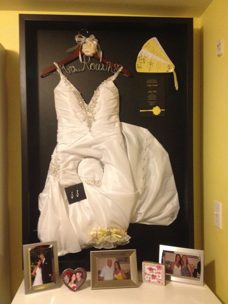 I couldn't think of a better way to display my wedding dress. I included my jewelry, my personalized hanger, my garter, my invitation, and my program. I think it turned out great and looks great in my dressing room!