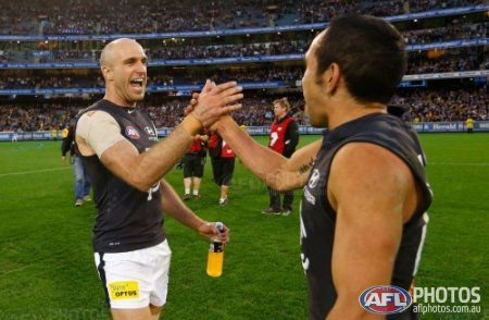 Chris Judd of the Blues (left) and Eddie Betts of the Blues celebrate during the 2013 1st Elimination Final match between the Richmond Tigers and the Carlton Blues at the MCG, Melbourne on September 08, 2013. (Photo: Michael Willson/AFL Media)