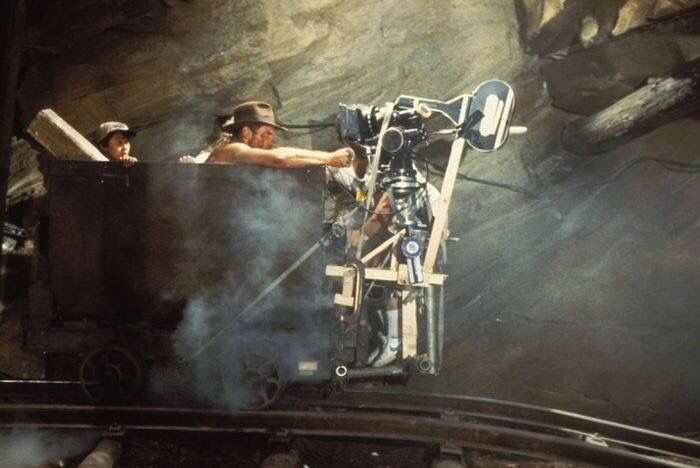 Jonathan Ke Quan, Harrison Ford & Kate Capshaw filming the mine cart scene behind the scenes on #IndianaJones and the Temple of Doom (1984).
