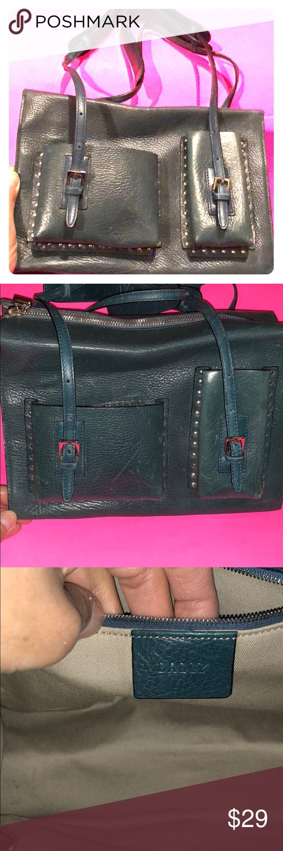Bally Leather Dark Teal Shoulder Bag This Bally leather shoulder bag is from the expensive Bally Shoes and Bags company that make beautifully made bags from Italy. This bag is not just a small bag, it's more of a medium size with a lovely dark teal color. It was used but is in good condition. It is definitely unique and very luxurious to own. Also, it looks smallish when closed and on your shoulder but when you open it, it fits belongings like a medium sized bag. Ingenious! Bally Bags…