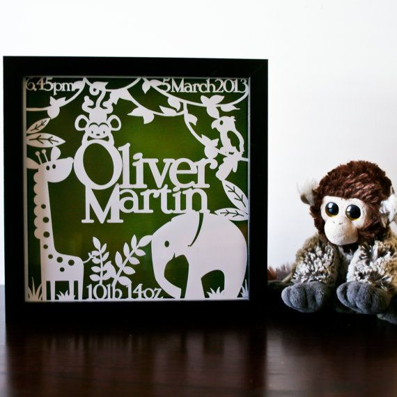 This playful framed paper art piece is personalised with babys name, weight, and date & time of birth.  Inspired by my sons jungle nursery theme, this papercut features a sweet giraffe, elephant and parrot as well as a cheeky monkey swinging from the vines.  Cut out of a single piece of white card, your personalised papercut is framed in a square shadow box frame. This shows off the intricacy and depth of the papercut, as it appears to float and casts shadows that play across the coloured...