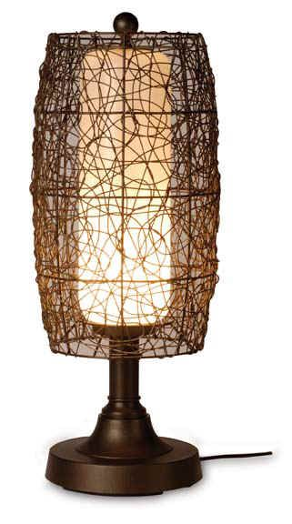 Bristol Outdoor Table Lamp Bring an exotic element to outdoor spaces and let the Bristol table lamp shine as the sun sets. A never-ending maze of twine-like PVC forms a barrel-shaped wicker surround for the protective polycarbonate inner cylinder. It sets any area aglow, perched on a weighted resin base with raised platform. Topped by a classic ball finial, this contemporary lamp is a weatherproof fixture that radiates relaxing golden hues from accent tables in outdoor furniture groupings.