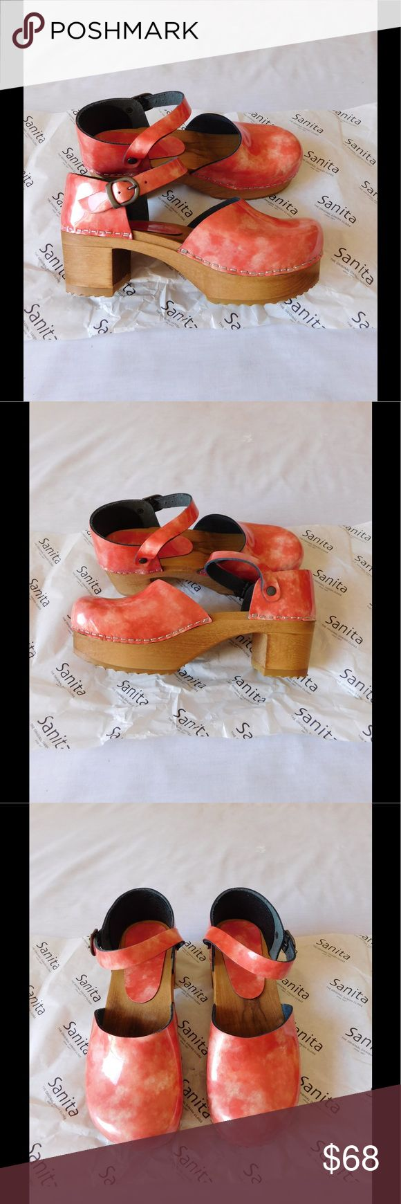 Adorable Coral Sanita Wooden Clogs W/Straps NWOT. These pair of clogs are really cute and adorable. Super comfy style. Gorgeous colors. Size 8.0W but fits 9.0 as well. Negotiable Price. Sanita Shoes Mules & Clogs