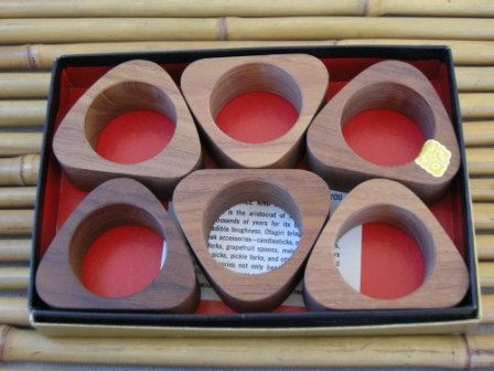 This is a set of unused Midcentury Modern teak napkin holders in mint condition in their original box. They are a beautiful wood finish made in Japan in