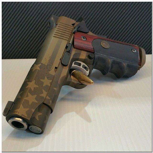 By  texotahydrographics Kimber Tactical Pro II done with faded faded glory Burnt Bronze and Graphite Black Cerakote    cerakote  handgun  firearm  kimber  45