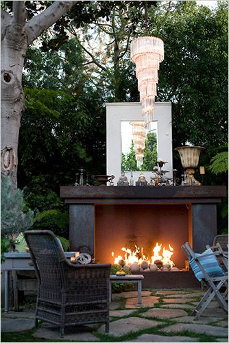 Love the fire place on the outside deck, very nice for company or a romantic evening but id put nice pretty flowers on top instead of decorations that could get ruined by the weather