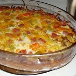 A delicious breakfast/brunch recipe using hash browns, diced ham, eggs, etc. Easy to make and everyone loves it!