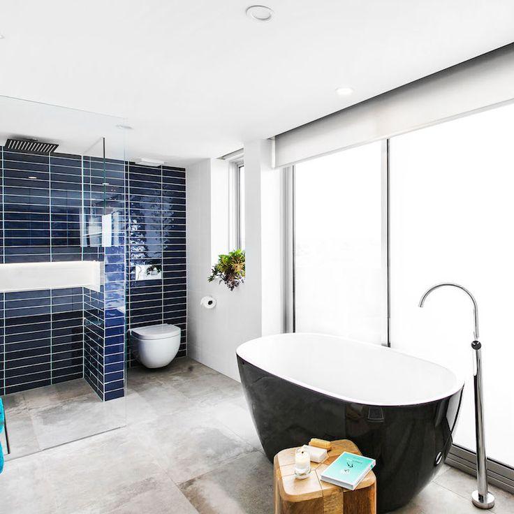 Ebony and Luke's master bathroom featuring the Argila Blue and Arkitek Grey tiles. From the Blockatgon 2015.