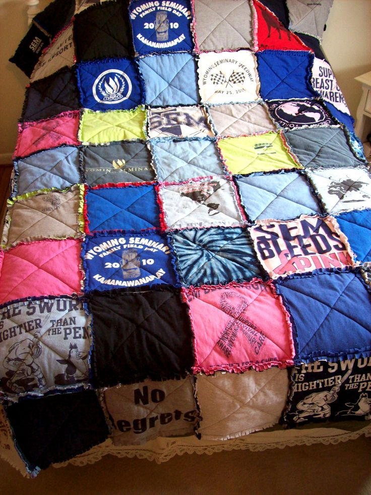 I want to do this with all of my t-shirts and sweatshirts i grow out ofTees Shirts, Ideas, Tshirtquilt, Tshirt Quilt, Quilt Made From Tshirts, Old Shirts, Concerts Tees, T Shirts Quilt, High Schools