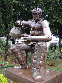 Estatua de un hombre preparando mate, en Posadas, Misiones, Argentina.
