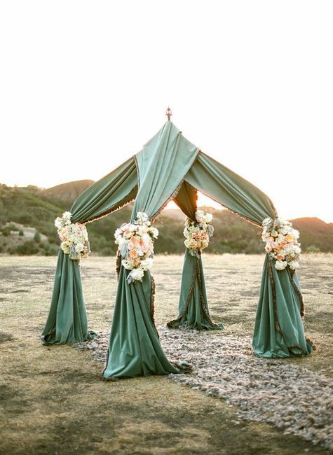 draped bridal canopy. Could use existing camping canopy poles and add drapery and flowers.