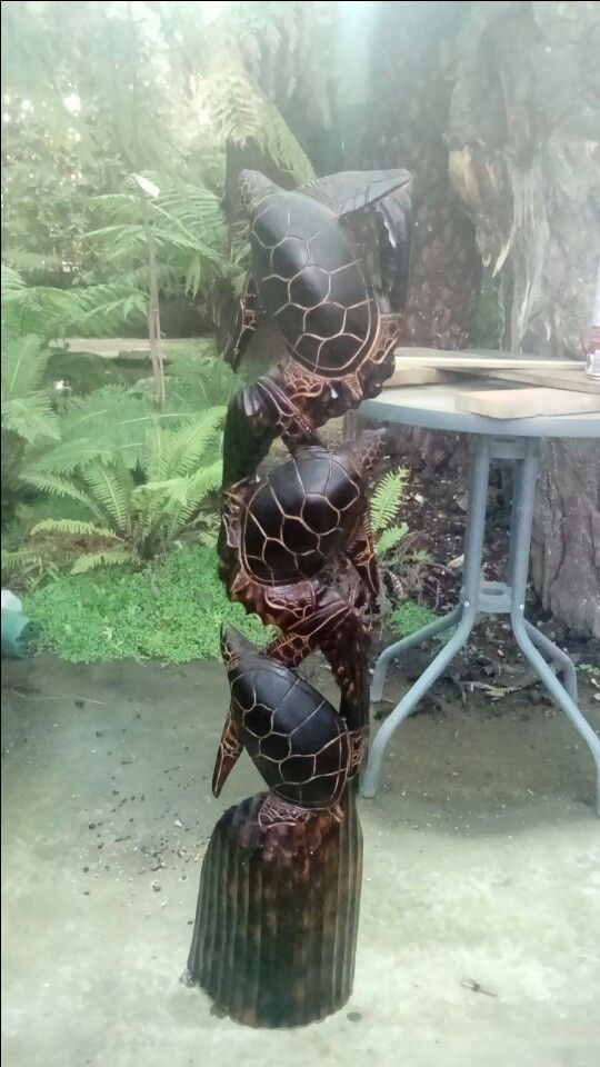 Rejuvenating old wood sculptures with a blow torch, after