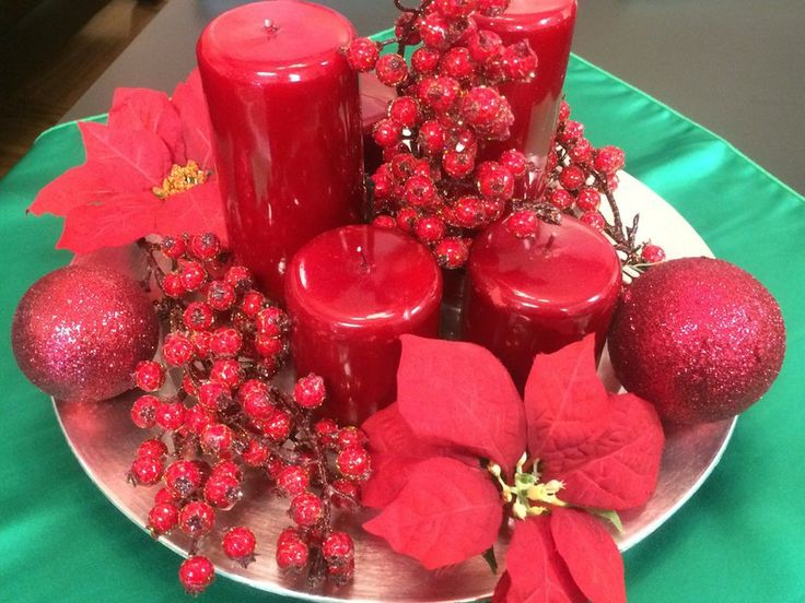 Gorgeous red centrepiece, perfect for Christmas dinner! From Big Top Tent Rentals