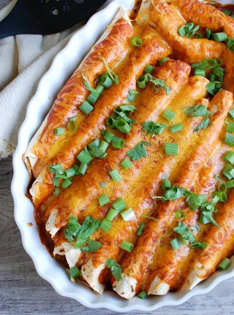 Vegetarian Black Bean Enchiladas make the perfect busy weeknight meal that can be prepped ahead and baked when ready. A black bean and vegetable mixture is topped with your favorite enchilada sauce and cheese and baked into a warm, gooey Mexican favorite. // A Cedar Spoon