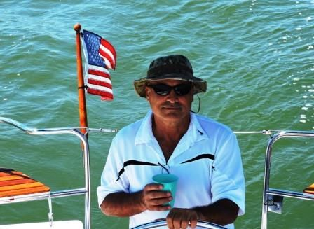 """FISHING VS. SAILING - Pat Grover is an avid fisherman from Sussex County. He has fished rivers and offshore. """"I prefer flat water to chop, but if it's choppy that's okay. There's more to fishing than fish."""" We went from 10 mph wind to zero, learning there's more to sailing than wind."""