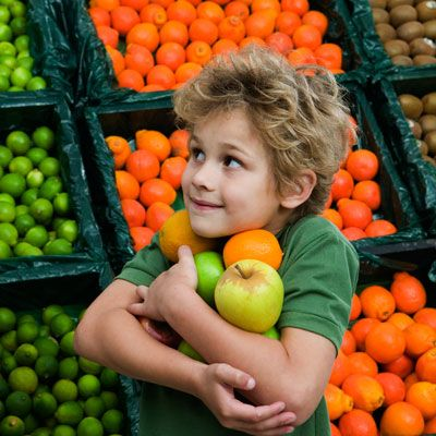 Want healthy kids? Take 'em to the farmers' market and let them pick out their own fruits and vegetables. When kids get involved in shopping and cooking, they're more likely to clean their plates—veggies and all.
