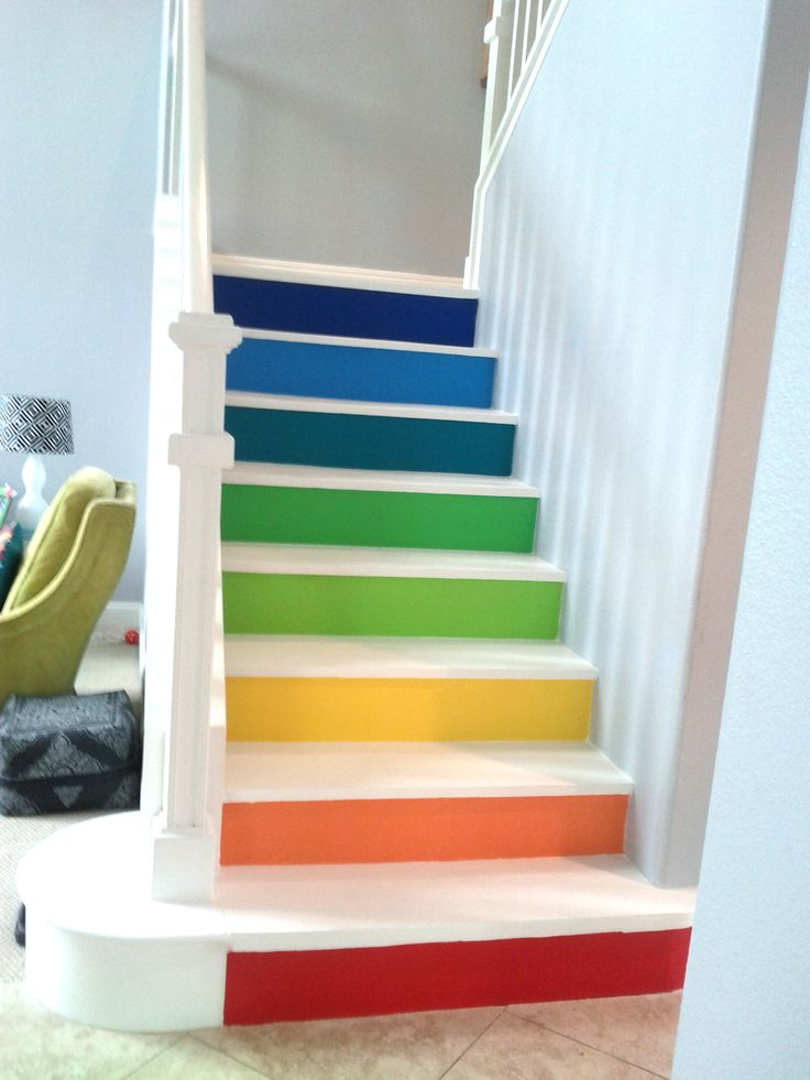 Bright painted rainbow stair risers with white treads, would want this for something when I have children