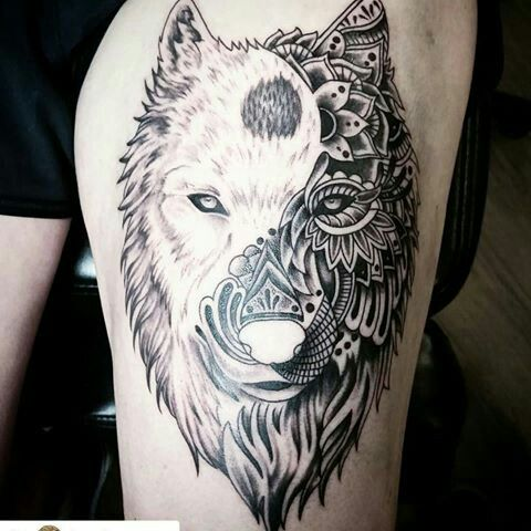 Yin-Yang; A clockwise taijitu whose elements are found among the features of a Wolf tatoo.
