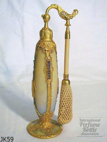 """DeVilbiss Imperial series  Fry foval glass blank """"Imperial Series"""" with enameled yellow interior & foot.  Ornate metalwork set with amethyst square jewels."""
