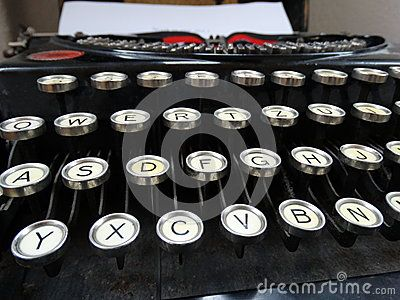 Old Typewriter from the 1920's. Focus on the letter buttons and unfocused on the red and black ribbon