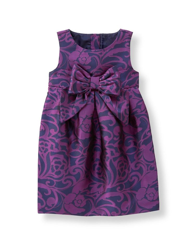 Our silky jacquard dress features a lush floral print and sash with bow.