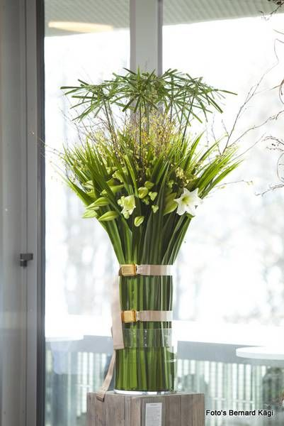 Lilies and Cyperus alternifolius arrangement -Florint: Swissflor 2012 - Luzern
