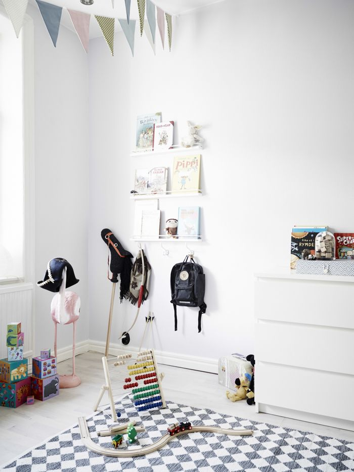 Scandinavian kids room with colorful details