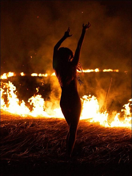 She's so beautiful her curves flowing up back lit from the flames to move & dance as she pleases.