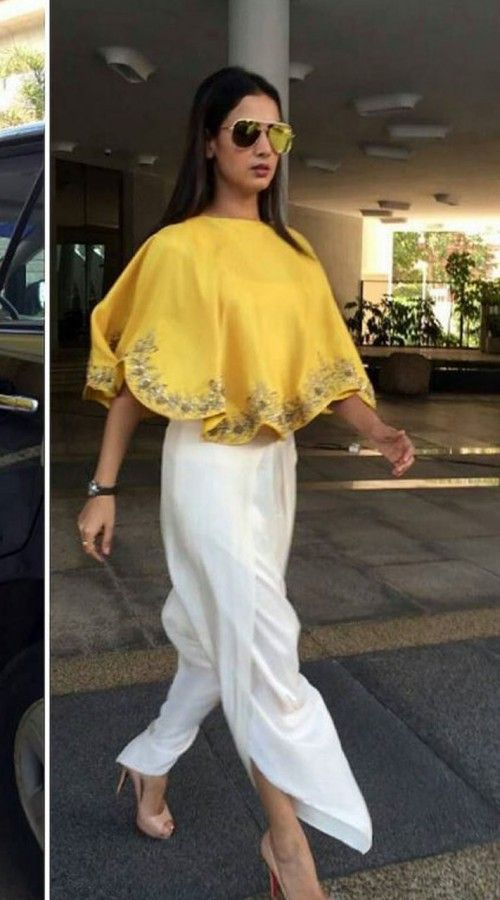 Modernistic Crepe Silk Designer Yellow Cape Top With Dhoti Pant BP0124 Beautifully crafted yellow crepe silk cape top with dhoti pant is to glam up for a party functions. This is a custom made design which can be made in any color and size. This can be made in low budget also, kindly contact us for more details.