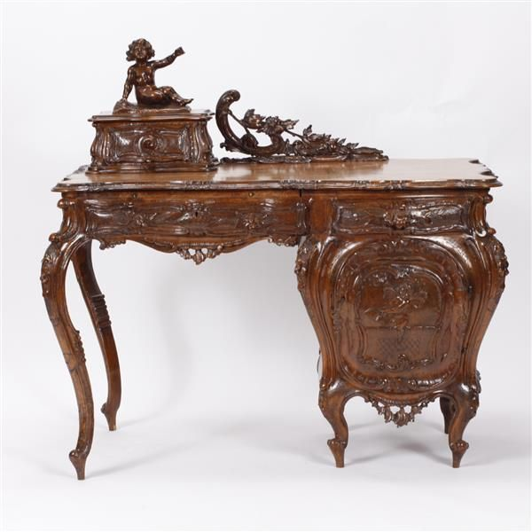 """Italian 19th century Renaissance Revival carved walnut writing desk; ornate and fine decoration allover and topped with a full putti figure. Style of Valentino Besarel. Unsigned. 42""""H x 45""""W x 24""""D."""